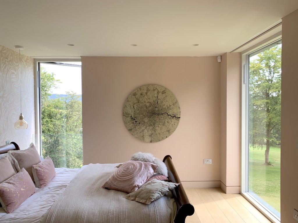Artwork by Ewan David Eason hangs in a bedroom