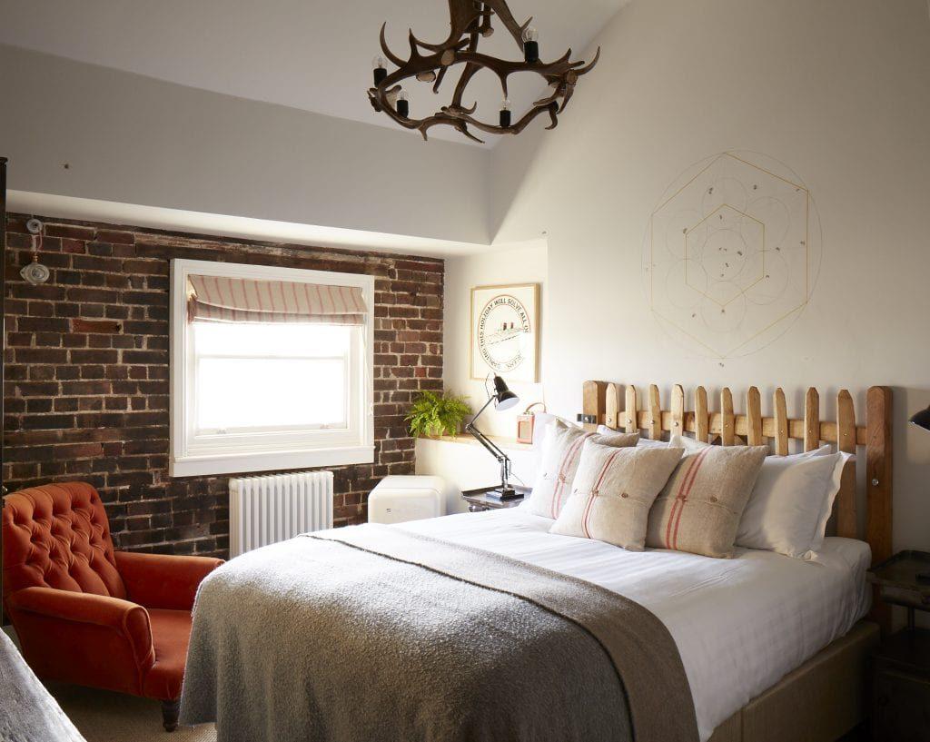 Adam Bridgland featuring in a tranquil bedroom in Brighton